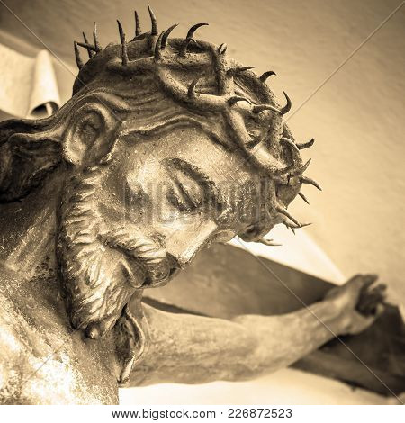 The Suffering Of Jesus Christ. Details Of The Bronze Statue. Sepia Tone.