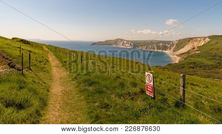 Walking On The South West Coast Path, Looking At Worbarrow Bay, Near Tyneham, Jurassic Coast, Dorset