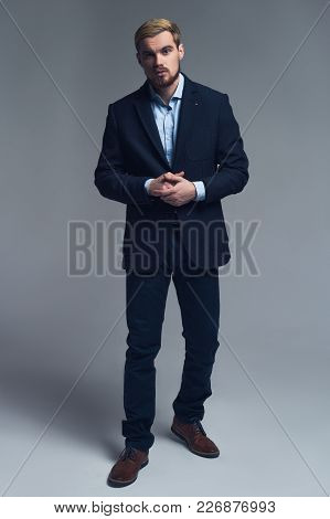 Confident And Professional. A Full-length Portrait Of Business Man In Stylish Costume In Front Of Th