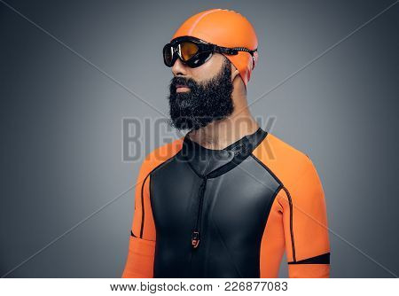 Bearded Scuba Diver Male In Orange Neoprene Suit Isolated On Grey Background.