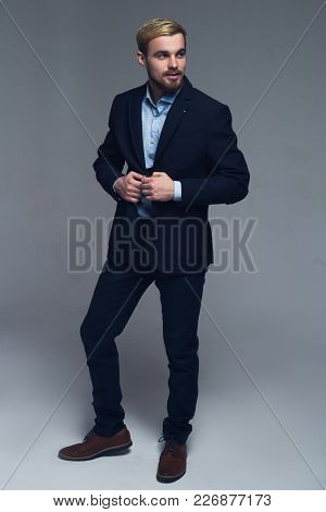 Professional And Stylish. A Full-length Portrait Of A Business Man Holding The Lapels Of His Jacket