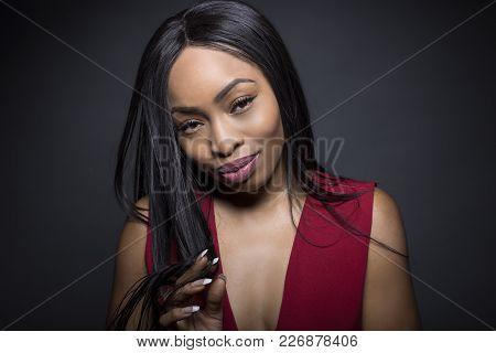 Black Female Model On A Dark Background With Money Gesture Expressions.