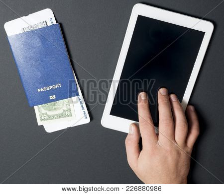 Business Air Travel, Mobility And Communication Concept: Tablet Pc Or Buying Airliner Tickets Online