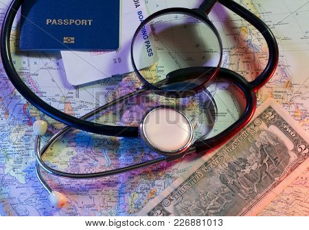 Concept Doctors Without Borders, Stethoscope, Tickets, World Map And Passport