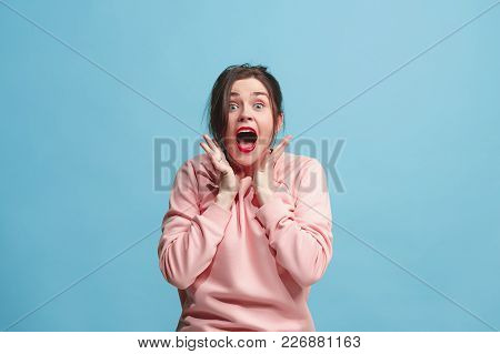 Beautiful Female Half-length Portrait Isolated On Blue Studio Backgroud. The Young Emotional Screami