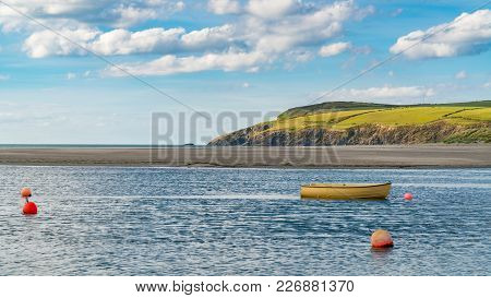 A Boat And Some Buoys At Pembrokeshire Coast In Parrog, Dyfed, Wales, Uk