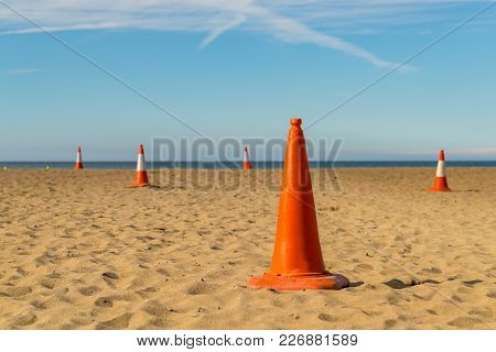 Pylons On The Beach, Seen In Aberporth Bay, Ceredigion, Dyfed, Wales, Uk