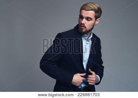 Serious And Professional. Young Business Man Holding Lapels Standing And Watching Aside In Front Of