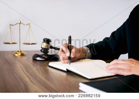 Male Lawyer Or Judge Working With Law Book, Gavel, Report The Case On Table In Modern Office, Law An