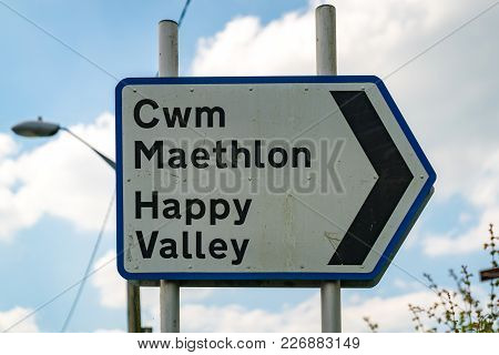 Sign: Happy Valley (welsh & English), Seen In Cwrt, Gwynedd, Wales, Uk
