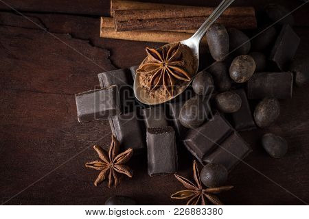 Black Chocolate, Spices, Tea Spoon On Wooden Background