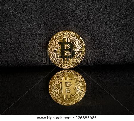 Bitcoin On A Dark Background With Reflection
