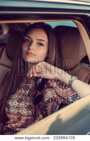 Sexy Long Hair Woman Posing In A Car.