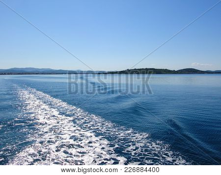 Sea Water Ship Trail With White Foamy Wave. Tropical Islands Ferry Travel. Bubble Tail After Cruise