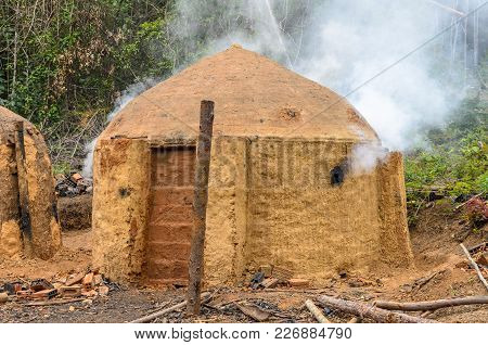 Charcoal Kilns On The Eucalyptus Farm In Minas Gerais , Brazil.