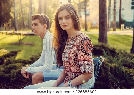 Blond Woman And Her Boyfriend Posing In Summer Park.