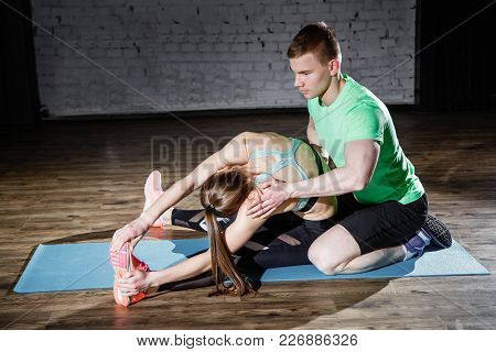 Sport, Fitness, Lifestyle And People Concept - Smiling Woman With Male Personal Trainer Exercising I