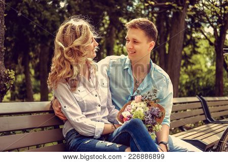 Loving Adult Couple In Summer Park In Sunny Day.
