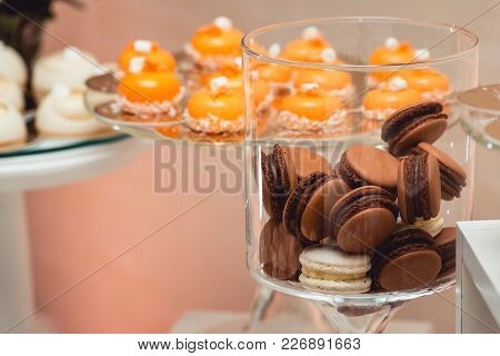 Colorful Pastel Beige Brown Vanilla Coffee Chocolate French Macaroon Biscuit In A Glass Jar.