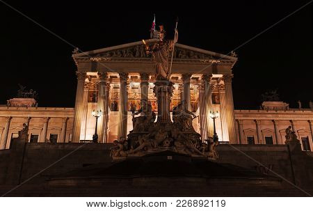 Pallas Athene Fountain at night. Located in front of the Austrian Parliament Building, was erected between 1893 and 1902 by Carl Kundmann, Josef Tautenhayn, Hugo Haerdtl