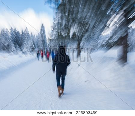 View Of Tourists At Ski Resort In Motion Blur. Blurred Ski Resort Background