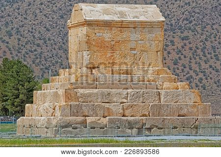 Pasargad, Iran - May 4, 2015: Tourists Checking Out The Tomb Of Cyrus The Great.