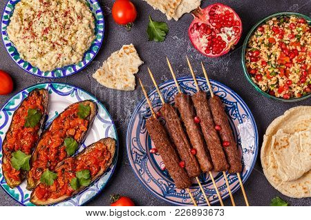 Classic Kebabs, Tabbouleh Salad, Baba Ganush And Baked Eggplant With Sauce.