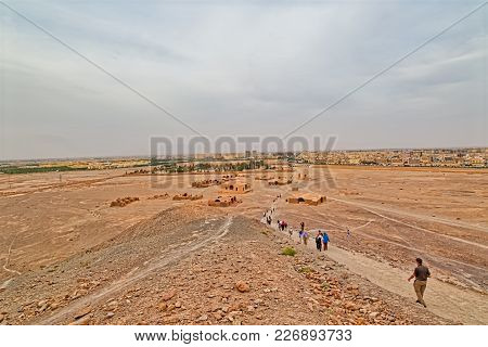 Yazd, Iran - May 4, 2015: View Of The Tower Of Silence Disused Buildings At The Foot Of The Hills An