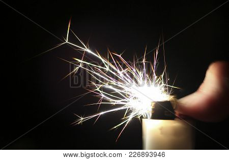 Sparks Take Colorful Crystalline Shapes As They Come Out Of A Cigarette Lighter.