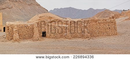 Yazd, Iran - May 4, 2015: Disused Building At The Foot Of The Hill.