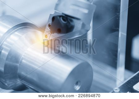 Close Up Of The Cnc Lathe (turning Machine)cutting Metal Shaft With The Lighting Effect. Hi-precisio