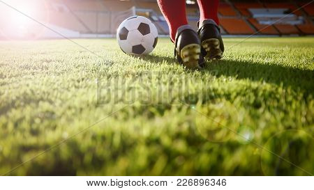 Soccer Or Football Player Standing With Ball On The Field For Kick The Soccer Ball At Football Stadi
