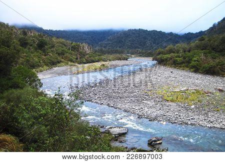 The Toaroha River Flows Through The Cedar Flats Area On The South Island Of New Zealand.
