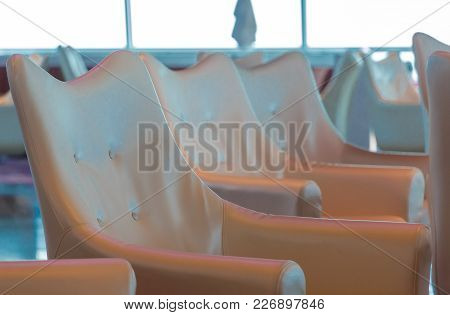 A Line Of Vinyl Chairs On Cruise Ship