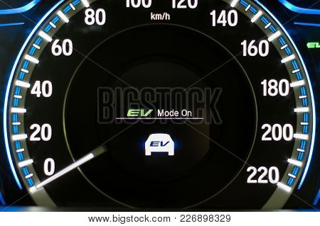 Ev- Electrical Vehicle Mode Turned On On Hybrid Car Screen In Front Of Steering Wheel For Green Powe