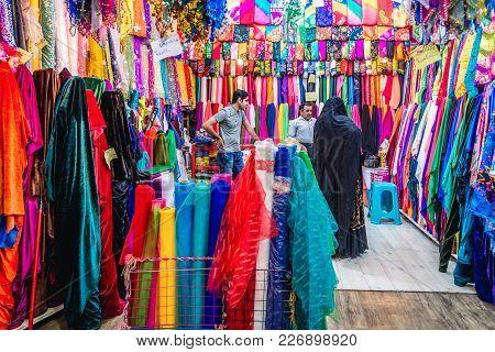 Shiraz, Iran - October 23, 2016: Iranian Woman Buys Textiles On The Hagi Bazaar In Shiraz City