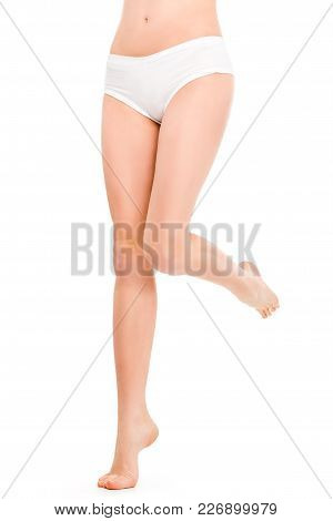 Low Section View Of Girl In White Panties, Isolated On White