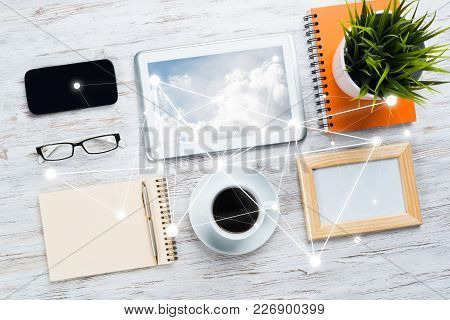 Top View Of Modern Workplace With Office Stuff And Social Network Connection Above As Symbol Of Stil