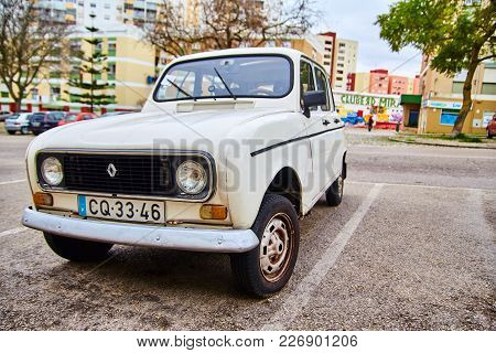 Lisbon, Portugal - January, 2018. White Old Vintage Retro Car Of Renault Brand On The Street Of Lisb