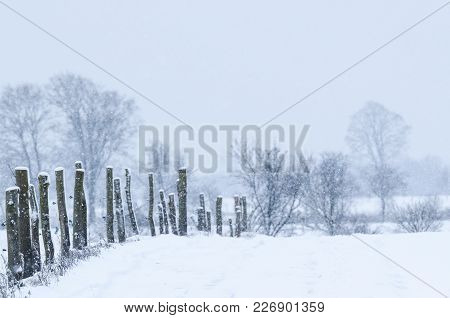 Winter - A Dirt Road And An Old Fence Covered With Snow