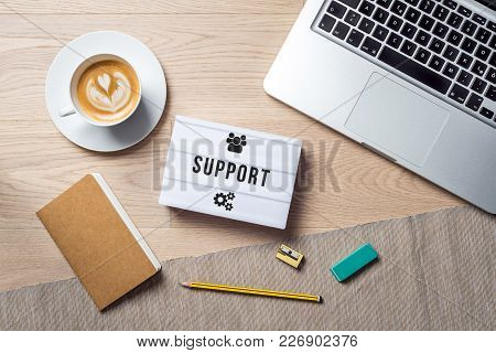 Support Writing In Lightbox Lying On Desk As Flatlay
