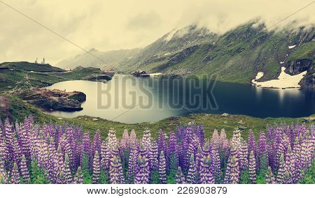 Nature Landscape. Balea Lake, Fagaras Mountains, Romania . With Overcast Clouds In The Sky. And Blue