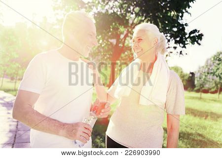 In Love. Waist Up Of Cheerful Elderly Couple Looking At Each Other While Showing True Feelings