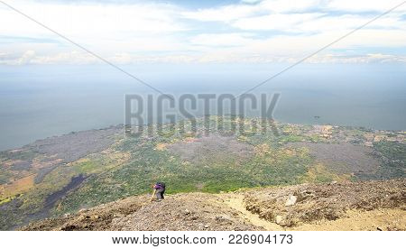 A Hiker Climbs Up Volcan Concepción On The Island Of Ometepe, Nicaragua.