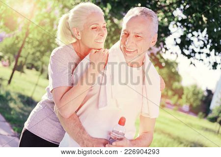 Sweet Time. Waist Up Of Cheerful Couple Standing Close To Each Other While Being Happy And Pleased