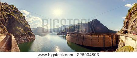 Summer Scenery. Of Vidraru Lake And Dam Glowing In Sunlight. Creative Image. Location. Vidraru Dam,