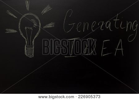 Drawn Light On Blackboard With The Text: Generating Idea