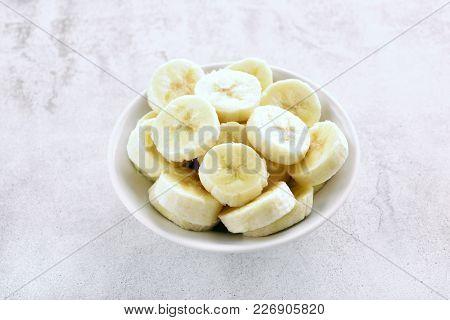 Sliced Peeled Banana In Bowl. Healthy Vegetarian Vegan Food. Close Up View