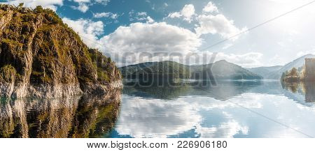 Wonderful Sunny Landscape. Mountain Lake With Perfect Sky Reflected In Water. Of Vidraru Lake And Da