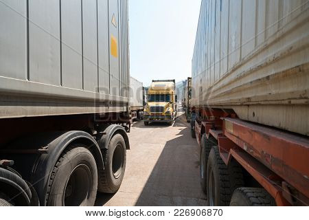 Heavy Trucks Loaded With Goods Trailers, Parked In Waiting Area On State Border Crossing In Vietnam